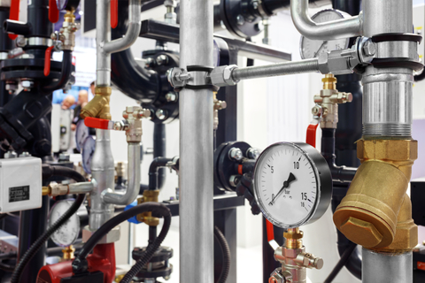 The equipment of the boiler-house, - valves, tubes, pressure gauges, thermometer. Close up of manometer, pipe, flow meter, water pressure